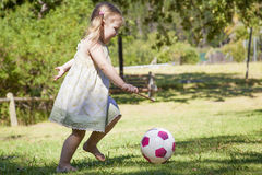 Little girl play in the park. Little girl plays in the park by herself Royalty Free Stock Photography