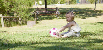 Little girl play in the park. Little girl plays in the park by herself Royalty Free Stock Image