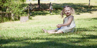 Little girl play in the park. Little girl plays in the park by herself Stock Photography