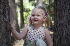 Little girl play in the park. And the trees Stock Images
