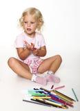 Little girl play with pen Stock Photos