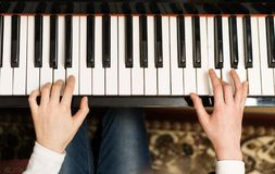 Little girl play the piano royalty free stock image