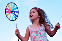Little girl play with pinwheel  toy windmill Royalty Free Stock Images