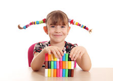 Little girl play with plasticine Royalty Free Stock Photo