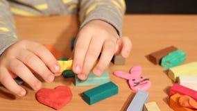 Little girl play with plasticine Stock Photos