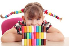 Little girl play with plasticine Stock Photography