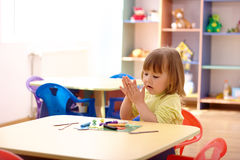 Little girl play with plasticine in preschool Royalty Free Stock Image