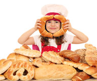 Little girl play with rolls Royalty Free Stock Photography