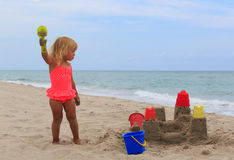 Little girl play with sand on beach. Cute little girl play with sand on beach Stock Photo