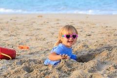 Little girl play with sand on beach. Cute little girl play with sand on beach Stock Photography
