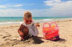 Little girl play with sand on beach. Cute little girl play with sand on beach Stock Photos