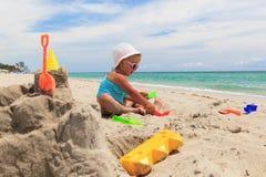 Little girl play with sand on beach. Cute little girl play with sand on beach Royalty Free Stock Photography