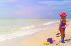 Little girl play with sand on beach. Cute little girl play with sand on summer beach Stock Image