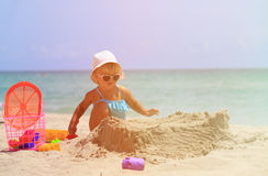 Little girl play with sand and toys on beach Royalty Free Stock Image