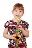 Little girl play saxophone Royalty Free Stock Photos