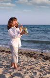 Little girl play saxophone on beach Royalty Free Stock Photos