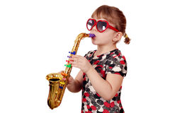 Little girl play saxophone Stock Photos