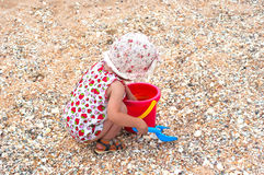 Little girl play on the sea coast Royalty Free Stock Images