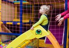 Little girl play on slide Stock Photography