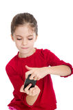 Little girl play with smartphone Stock Image