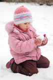Little girl play with snow in winter Stock Photo