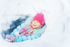 Little girl play in snow at winter park Stock Images