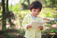 Little girl play with tablet Stock Images