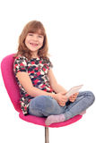 Little girl play with tablet pc Stock Photo