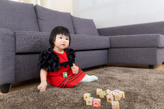 Little girl play toy block Stock Image