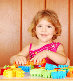 Little girl play with toy blocks Royalty Free Stock Photo