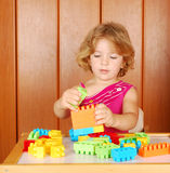 Little girl play with toy brick Stock Images