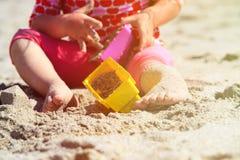 Little girl play with toys on beach Royalty Free Stock Photos