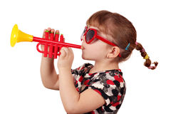 Little girl play trumpet Royalty Free Stock Photos