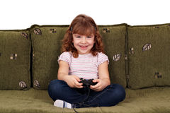 Little girl play video game Stock Image