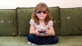 Little girl play video game stock footage