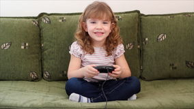 Little girl play video game Royalty Free Stock Photos