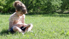 Little girl play video game on tablet stock footage