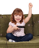 Little girl play video games Royalty Free Stock Image