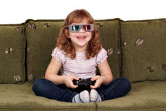 Little girl play video games Royalty Free Stock Photography