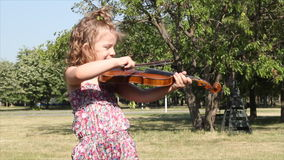 Little girl play violin stock video footage