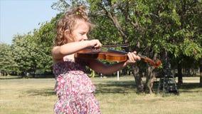 Little girl play violin Royalty Free Stock Photos