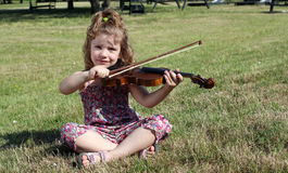Little girl play violin Royalty Free Stock Photography