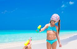 Little girl play with water pistol on tropical Stock Photos