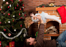 Little Girl Play With Dad Near Christmas Tree Stock Photos
