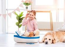 Free Little Girl Play With Sea Ship With Golden Retriever Dog Stock Photos - 214860203