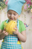 Little girl play with yellow chicks. Adorable little girls play with yellow chicks Stock Photos