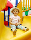 Little girl on playground Stock Photos