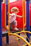 Little girl on playground Royalty Free Stock Image