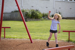 Little girl in playground Stock Photography