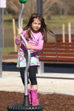 Little girl in a playground. Little girl playing on playground equipment Royalty Free Stock Photography